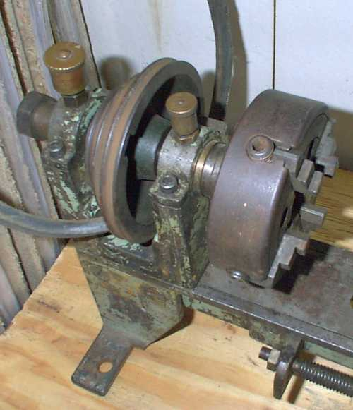 Lathe headstock with bearings, pully and 4 jaw chuck